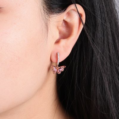 Aretes tipo argolla con mariposa