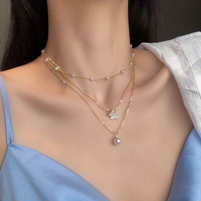 Collar de perlas de mariposa en capas